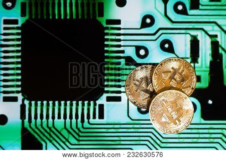 Conceptual Cryptocurrency Bitcoin With Computer Motherboard Circuit Background