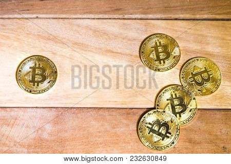 Conceptual Cryptocurrency Bitcoin On Wooden Table