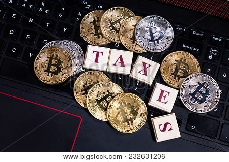 Conceptual Cryptocurrency Bitcoin With Word Taxes Breaking Up