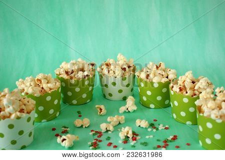 Popcorn In Paper Cups On Green Background