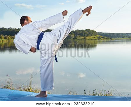 High Kick Leg Is Beating Athlete With A Blue Belt