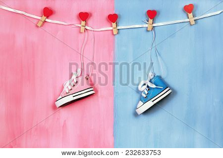 Baby Sneakers On Pink And Blue Background, Baby Shower Concept, Top View