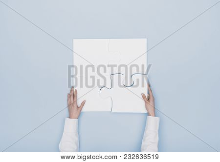 Woman Assembling A Jigsaw Puzzle
