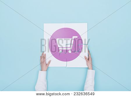 Woman Completing A Puzzle With A Shopping Cart Icon