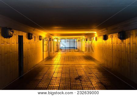 Underground Passage With Lights And Stairs In Glowing End.