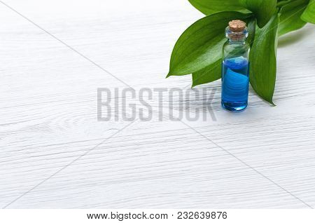Blue Essence Healing Tincture On White Wooden Table Background With Copy Space. Herbal Medicine Conc