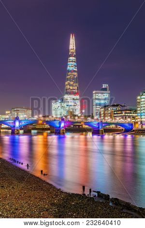 London, United Kingdom -january 17: This Is A Night View Of The Famous Shard Building Along The Rive