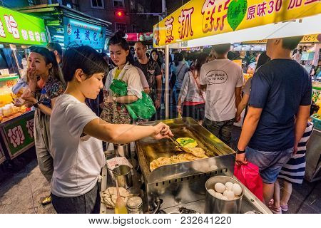 Taipei, Taiwan - May 20: Street Food Vendors In The Famous Shilin Night Market, A Popular Travel Des