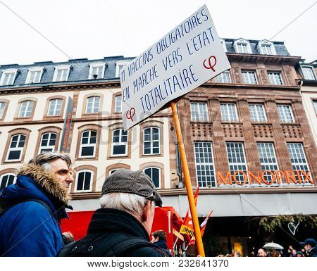 Strasbourg, France  - Mar 22, 2018: People With Flags And Placard At Demonstration Protest Against M