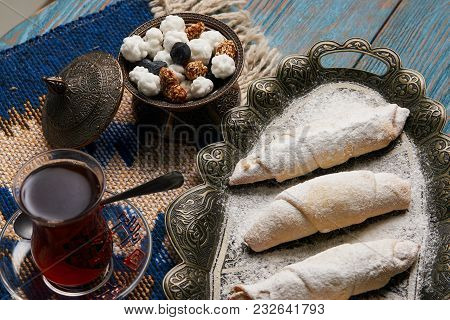 Homemade Mutaki Roll Cake With Walnuts And Sugar Powder, Oriental Sweets Mutaki Pastry And Tradition