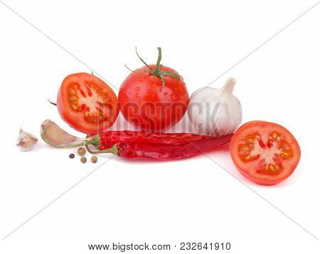 Fresh Vegetables Tomatoes Garlic Chili Peper On A White Background. Healthy Eating.
