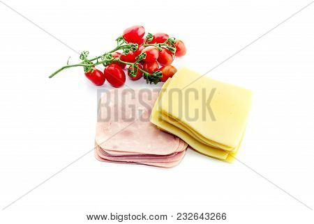 Fresh Cheese, Sausage And Cherry Tomatoes On A White Background Close-up