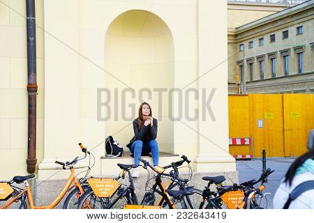 Munich Germany -september 9, 2017; Pretty Girl In Wall Girl Sitting Niche Twisting Hair By Hire Bicy