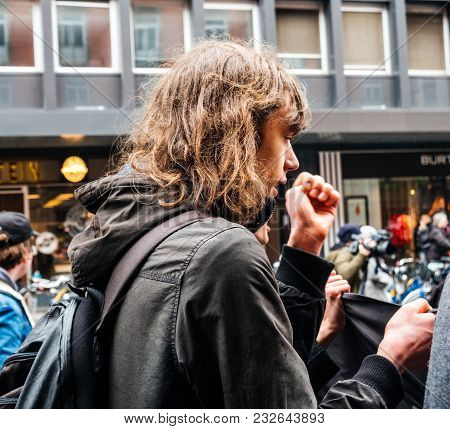 Strasbourg, France  - Mar 22, 2018: Young Man With Rising Fist At Demonstration Protest Against Macr