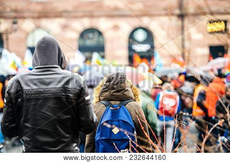 Strasbourg, France  - Mar 22, 2018: Rear View Of Adult And Young Men Wearing Hoodie Coat At Demonstr