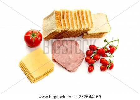 Fresh Cheese, Sausage, Sliced Bread And Cherry Tomatoes On A White Background Close-up