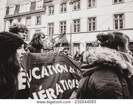 Strasbourg, France  - Mar 22, 2018: Front View Of Young Group With Banner Education In Danger At Dem