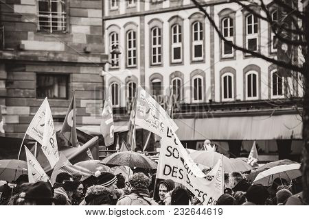 Strasbourg, France  - Mar 22, 2018: Crowd With Flags At Demonstration Protest Against Macron French