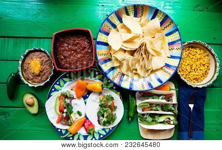 Colorful Mexican Lunch Of Tacos With Chips And Salsa.