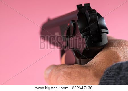 Male hand with gun
