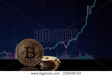Golden bitcoins on graph and diagrams background. Concept of trading cryptocurrency. Blockchain technology. 