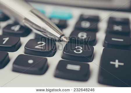 Calculator And Pen. Finance And Money Investment Concept