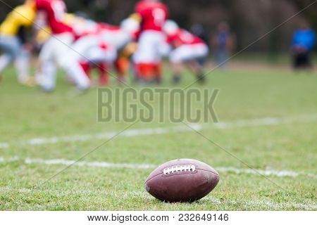 american football on the field - defocused players in the background