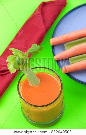 Glass Of Carrot Juice With Celery In It.