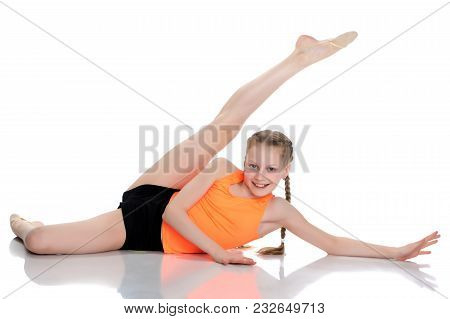 A Teenage Girl Is Engaged In Fitness. She Performs Various Exercises. The Concept Of Childhood, Spor