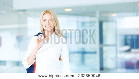 Young businesswoman standing in business center