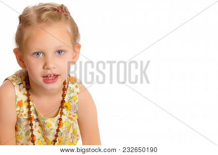 Beautiful Little Girl In Beads. The Concept Of Style And Fashion, Advertising Clothes And Accessorie