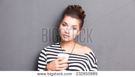 Portrait of  young woman with cup  tea or coffee