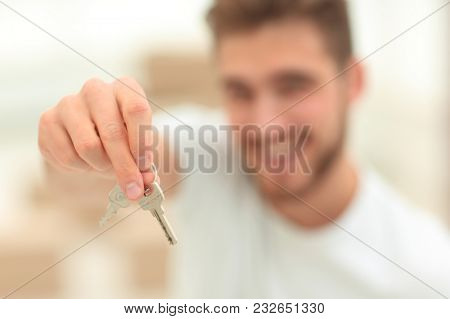 closeup.man showing keys of new apartments
