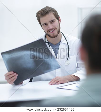 doctor examining x-ray picture of the patient