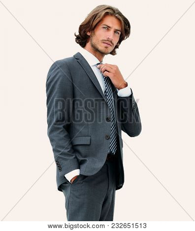 businessman straightening his tie isolated on a white background