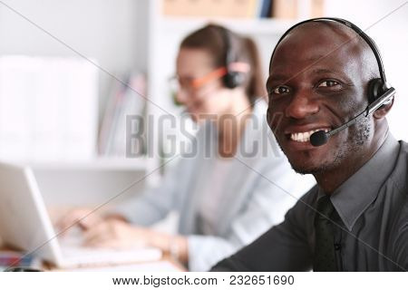 Business people working together at desk, white background