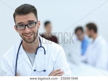 handsome doctor on blurred background