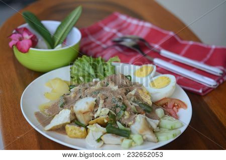 Indonesian Cuisine Gado-gado Salad With Peanut Sauce Reserved On White Porcelain Plate.