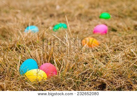 Colored Easter Eggs In Grass Forming A Trail To Find Nest 1
