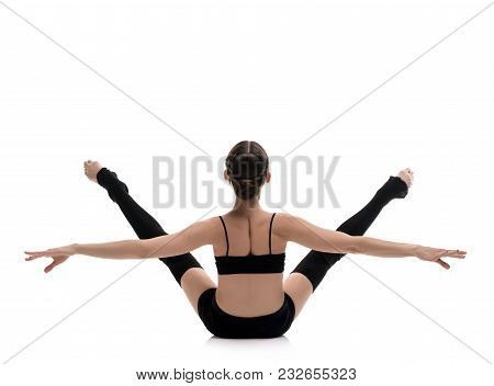 Slim Girl In Black Sportswear Streching Gracefully Isolated Rearview On White Background