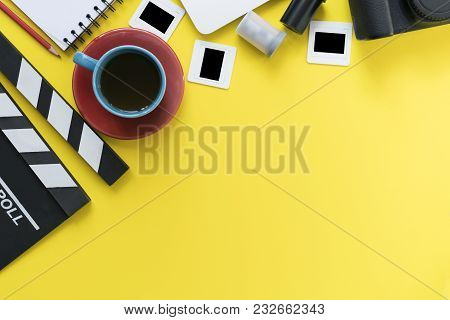 Movie Clapper And Accessories On Yellow Background; Film, Cinema And Video Photography Concept