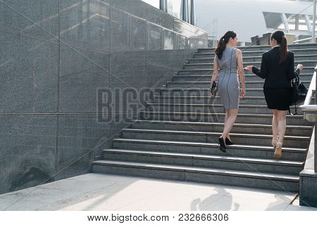 Modern Business Woman Climbing Stairs.