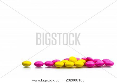 Pile Of Pink And Yellow Round Sugar Coated Tablets Pills Isolated On White Background With Copy Spac