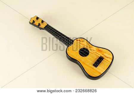 Close-up Of Toy Bass Guitar Object On A White Background