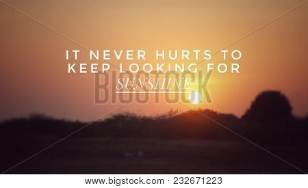 Motivational And Inspirational Quotes - It Never Hurts To Keep Looking For Sunshine. With Blurred Vi