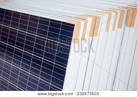 Blue Solar Panels Stacked In A Pile Or Row Alternative Energy Equipment Arrangement Photovoltaic Sys