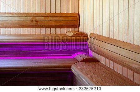 Luxury Wooden Bathhouse With A Glamour Illumination. Elegant Sunny Wooden Sauna Interior.