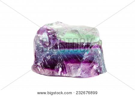 Macro Shooting Of Natural Gemstone. Raw Mineral Fluorite, Brazil. Isolated Object On A White Backgro