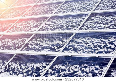 Photovoltaic Ecological Modules Slightly Blown By Snow. Close-up