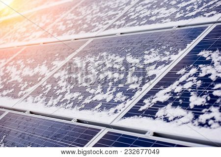 Alternative Electricity Source. Photovoltaic Solar Panels Covered With Snow On Top Of Modern House.